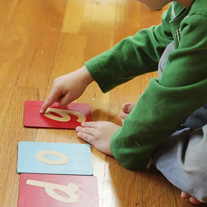 Child using Montessori Sandpaper Letters