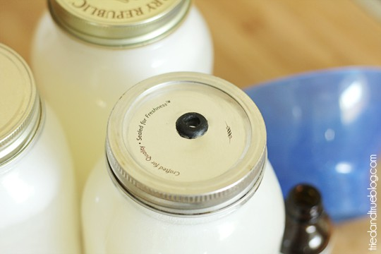 Mason jar lids with small open spout.