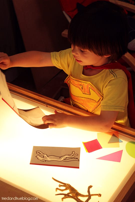 Child using play x-rays on a light table.