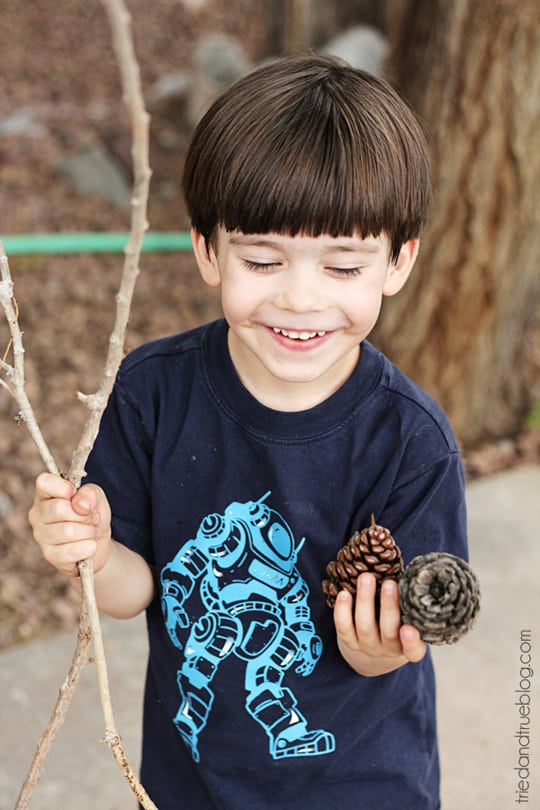 Gathering pine cones and sticks to make Thanksgiving toys with.
