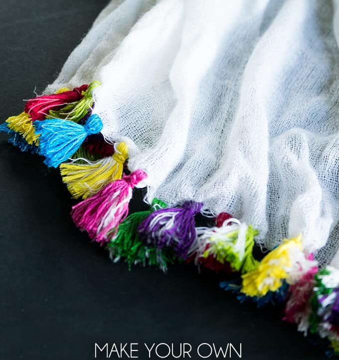 Make Your Own Tassel Scarf - Add a pop of color to a plain scarf with this tassel tutorial! #scarf #diyfashion