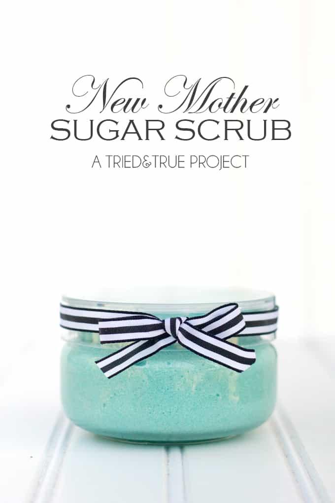 Glass jar with aqua sugar scrub.