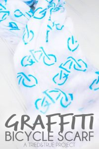 Super easy way to make a Graffiti Bicycle Scarf! Technique can be used with any thrift store scarf and stencil!