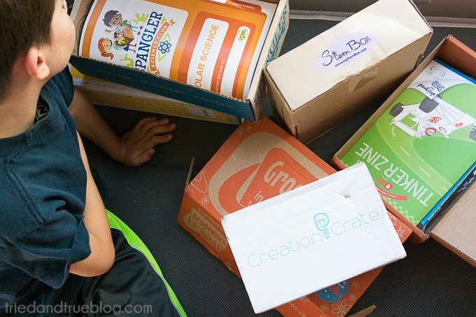 Child looking inside of the Steve Spangler subscription box for kids.