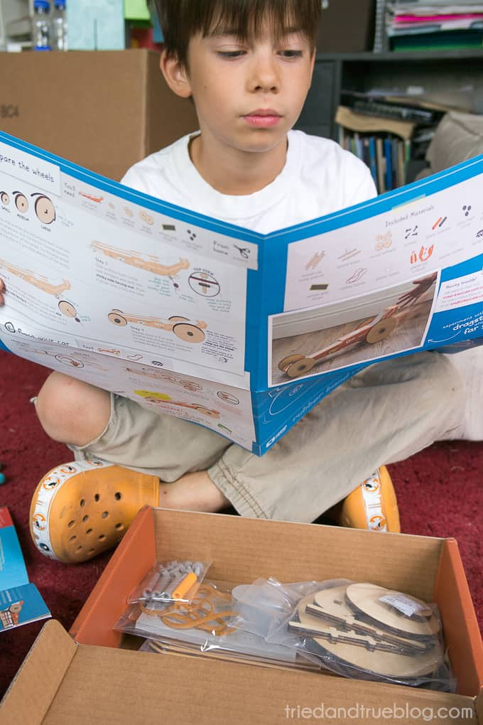 Child reading manual for the Tinker Crate.