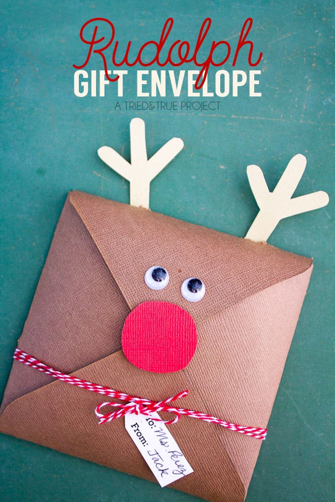 Brown gift envelope embellished to look like Rudolph.