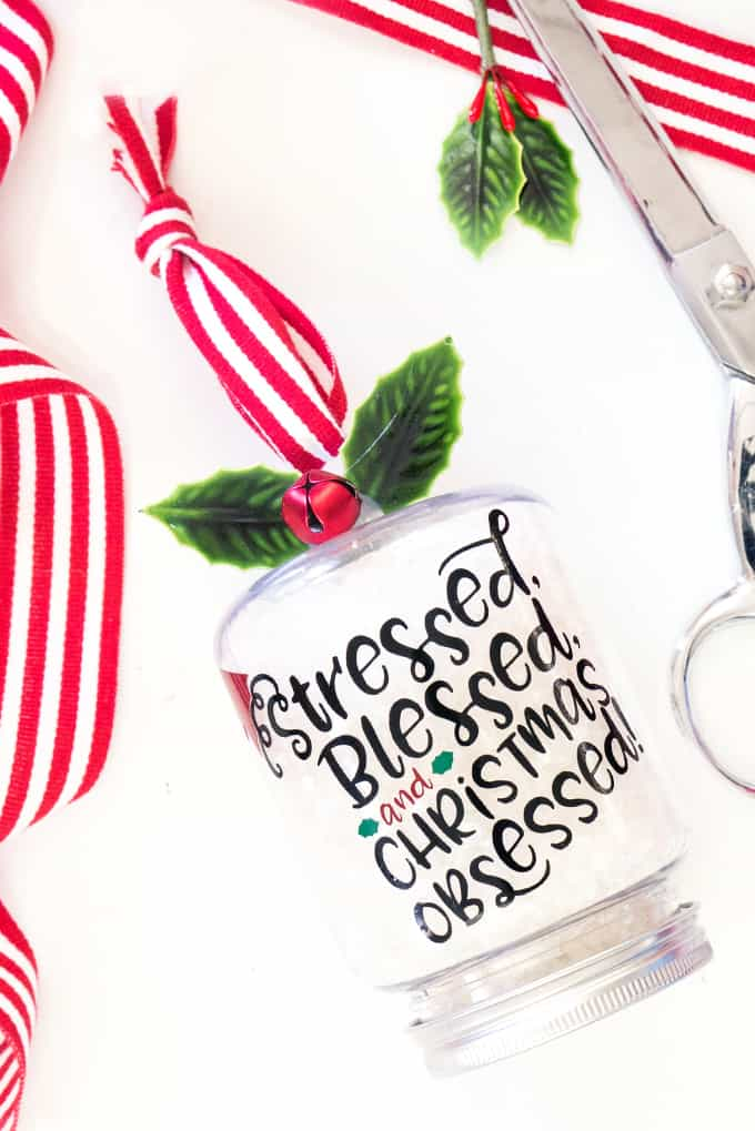 """Calming Christmas Bath Salts in a mason jar ornament with the words, """"Stressed, blessed, and Christmas Obsessed."""""""