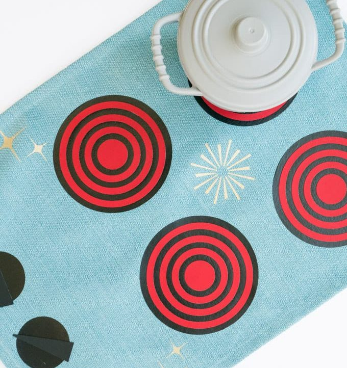 Make this super cute Mid-Century Fabric Play Kitchen with the free cut file!