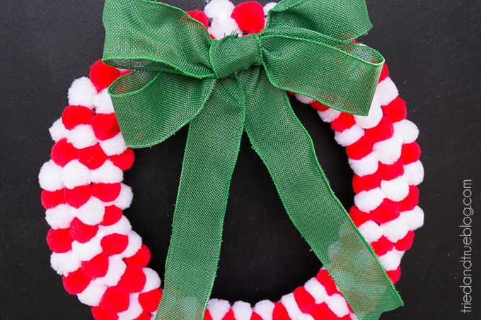 How To Make A Pom Pom Wreath In Minutes! - Hanging