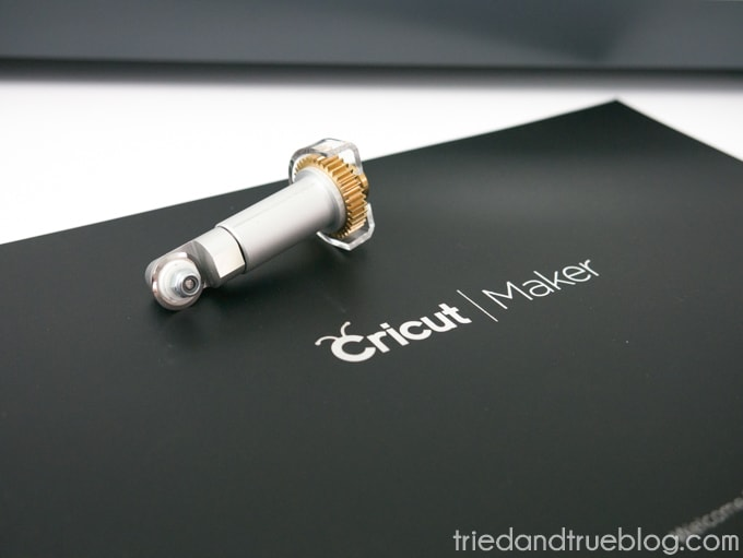 Image of rotary blade and booklet with Cricut Maker for Beginners FAQ