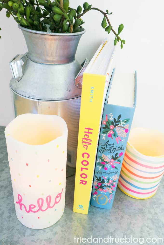 Set up of Decoupage Custom Candles with books and plants