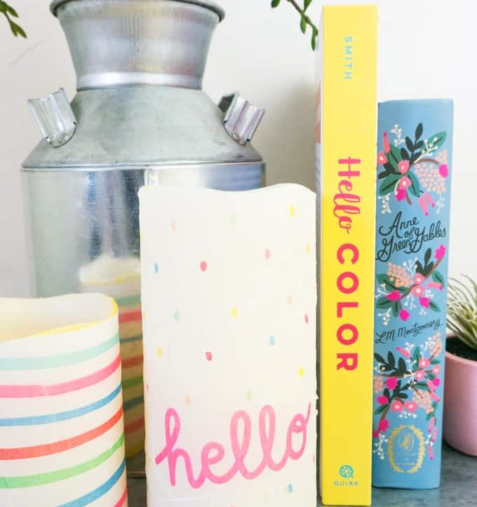 Set up of Decoupage Custom Candle with plants and books