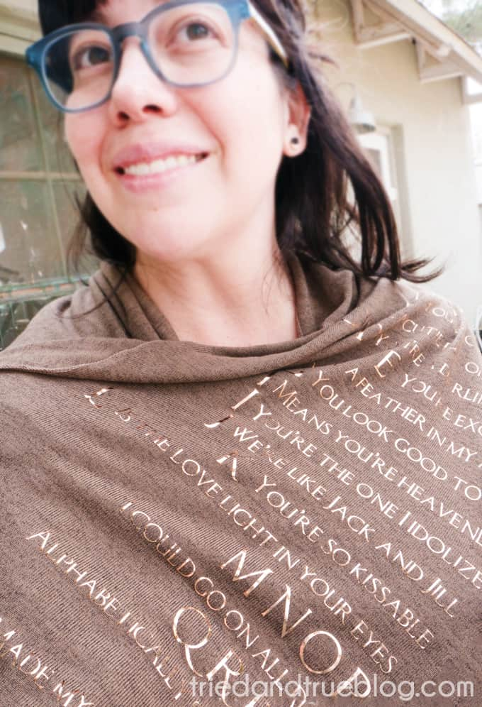 Woman wearing the Mother's Day Song Scarf outside