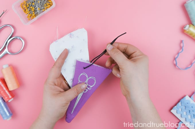Place the purple section inside of the white pouch and sew around the edge