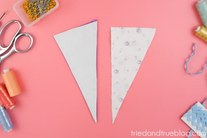 Sew fabrics together to make a triangular pouch