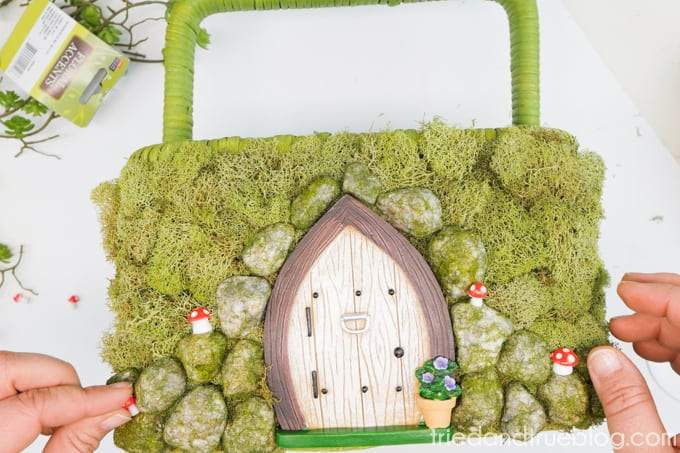 Embellish finished Spring Fairy Garden Basket with small mushrooms.