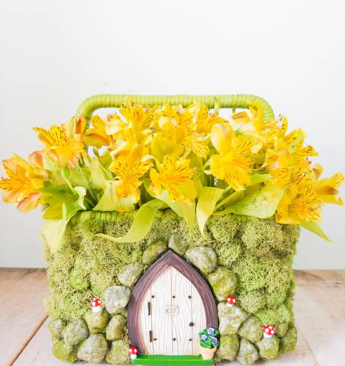 Transform a simple basket into this adorable Spring Fairy Garden Basket! Perfect for spring flowers and so much more!