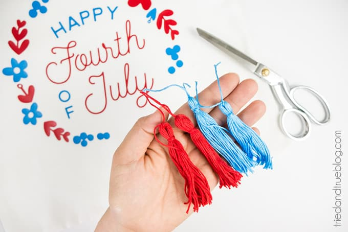Four red and blue tassels to be used on Fourth of July Pillow Cover