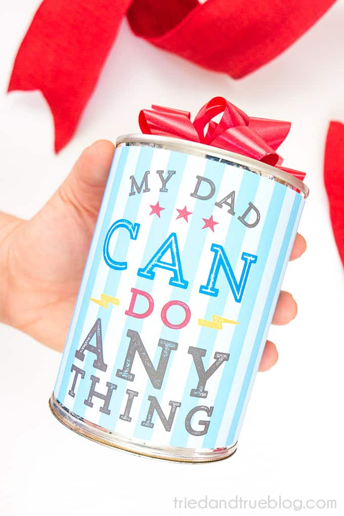 Hand holding Father's Day Gift Can