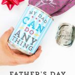 Hand holding the Father's Day Gift Can with tie