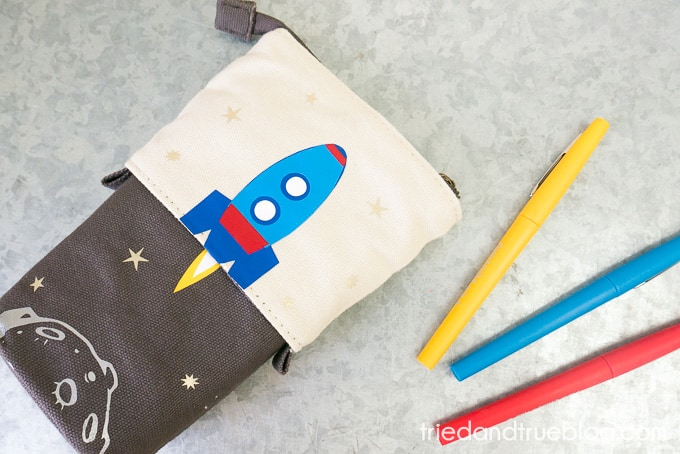 Collapsible Pencil Case with a space scene out of vinyl.