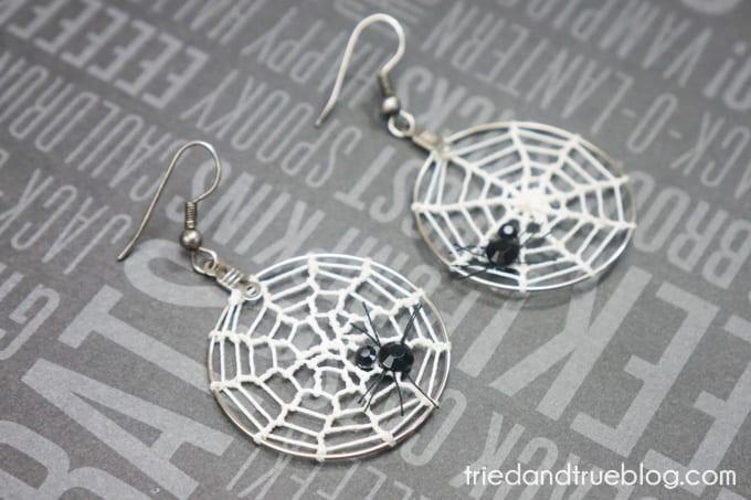 Hoop earrings with crochet spider webs and rhinestone spiders.