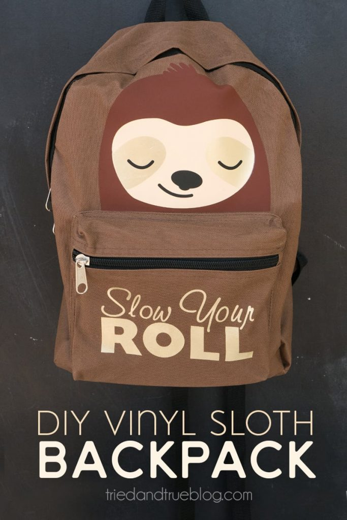 Brown backpack with vinyl sloth added and the words