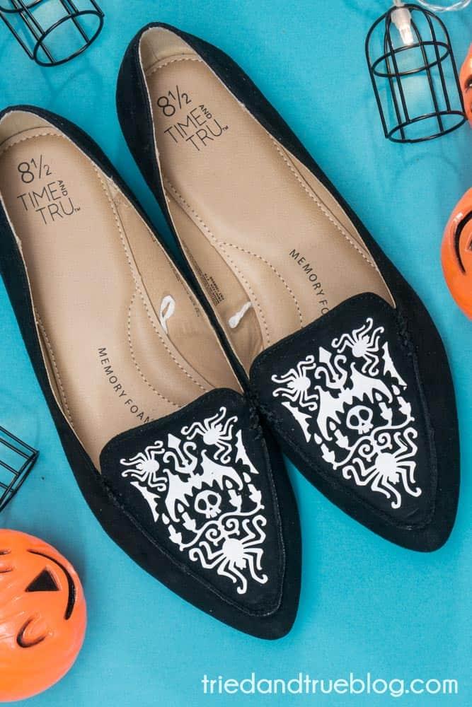 Custom Halloween Shoes with white vinyl.