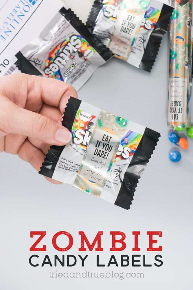 Hand holding a bag of Zombie Skittles in front of other bags. Each has Zombie Skittles Candy Labels on them.