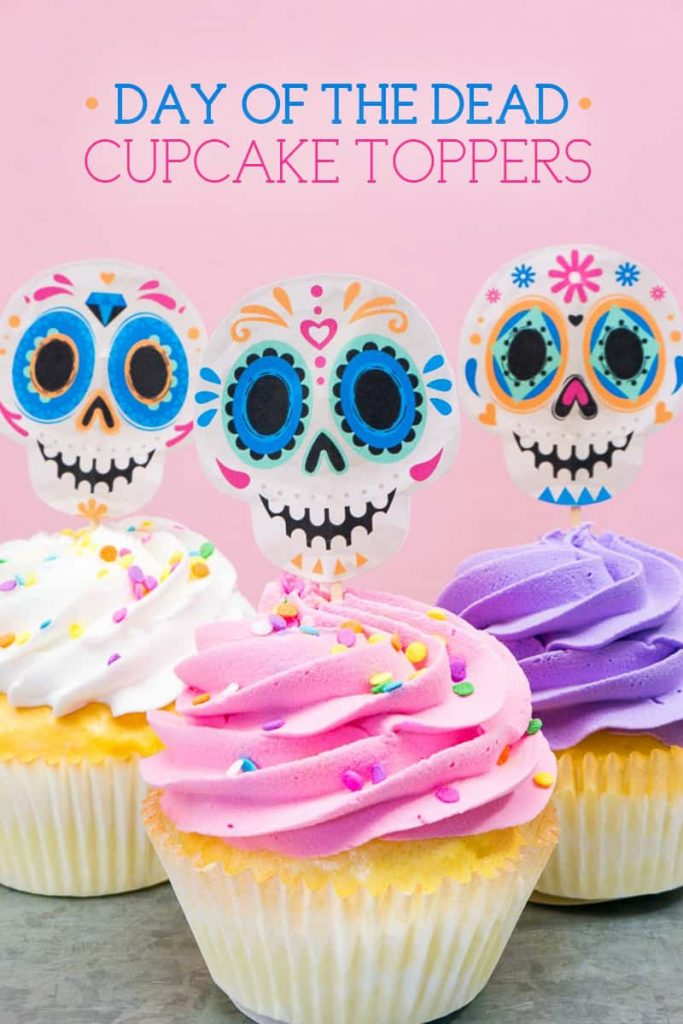 Three colorful cupcakes with Day of the Dead (Dia de los Muertos) Sugar Skull Cupcake Toppers