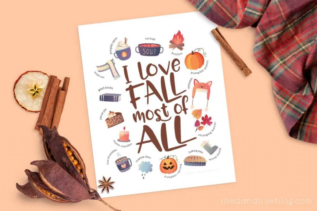 """""""I Love Fall"""" free printable surrounded by a scarf and cooking spices."""