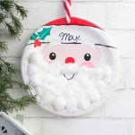 Super easy Christmas Countdown made with santa plate and cotton balls.