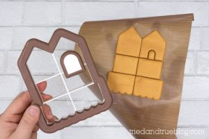 Use gingerbread house cookie cutter to cut clay.