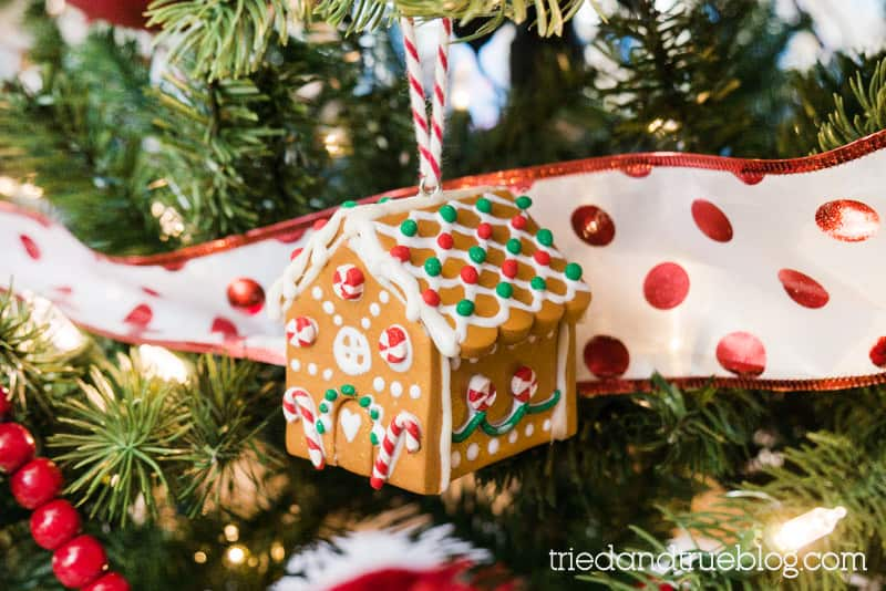 Clay Gingerbread House ornament hanging on a lighted tree.