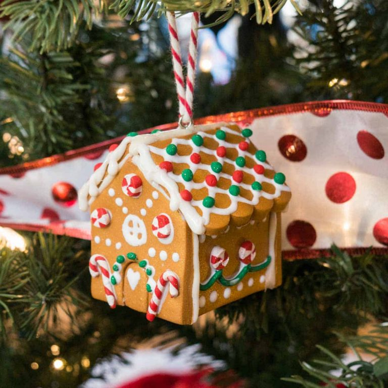 Gingerbread House Homemade Clay Ornament hanging from tree.