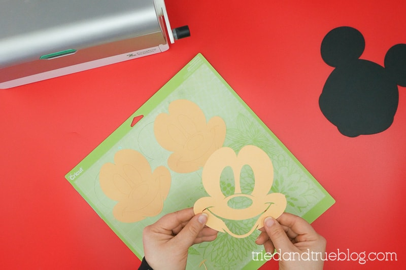 Removing a cut Mickey Mouse face from Cricut mat.