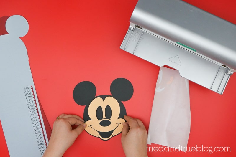 Assembling the Mickey Mouse face.