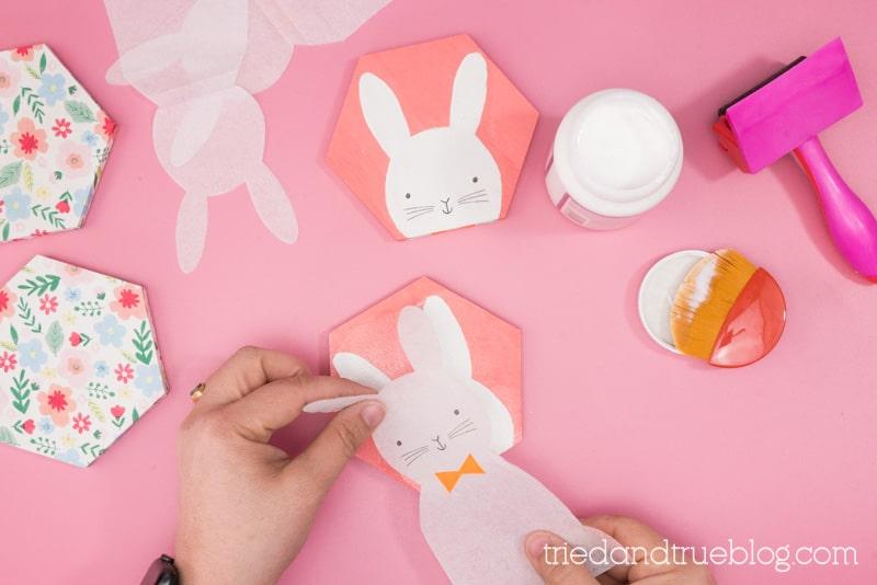 Layering a bunny napkin over the coaster.