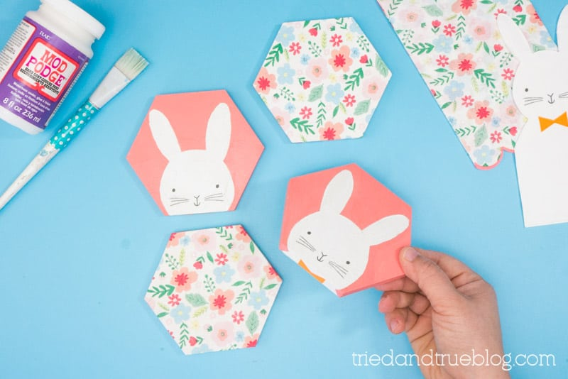 Hand holding Easter Bunny Decoupage Coasters.