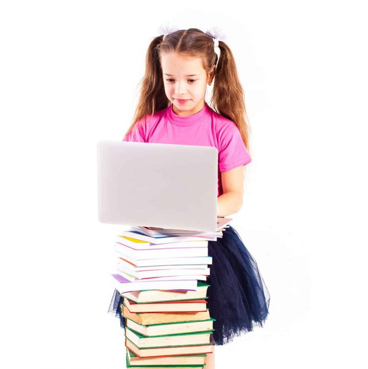 Young girl typing on a computer