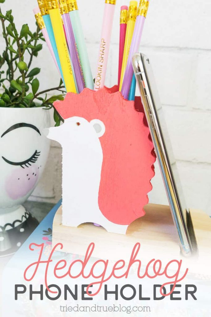 Pink and white Hedgehog Cell Phone Holder with pencils.