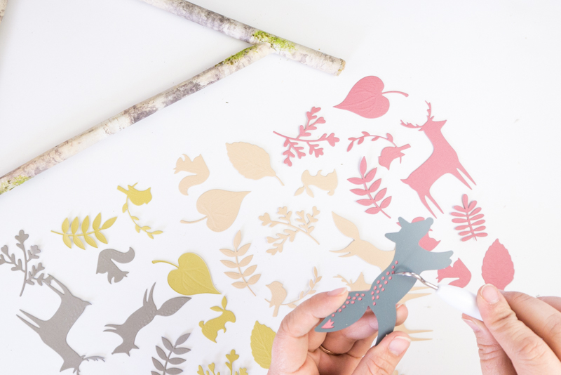 Paper cutouts of woodland creatures and leaves.