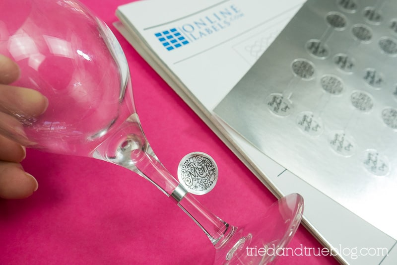Hand holding wine glass with the Mother's Day Circle label,