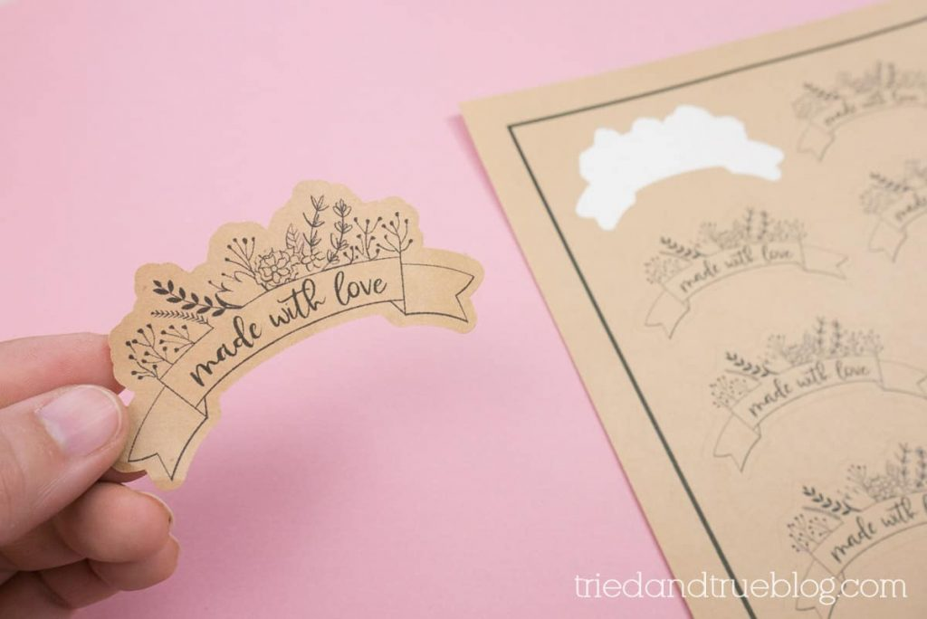 Hand holding Made with Love Packaging Stickers.