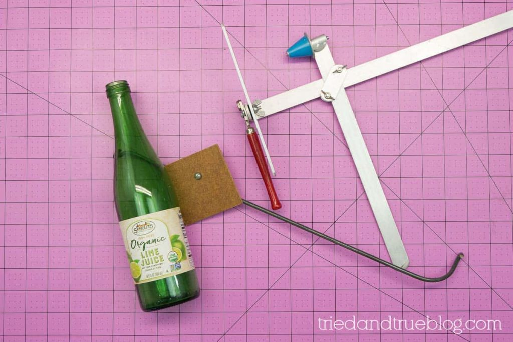 Supplies needed include glass cutter and empty recycled glass bottle.