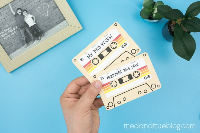 Hand holding Cassette Tape Father's Day Card Free Printable cards.