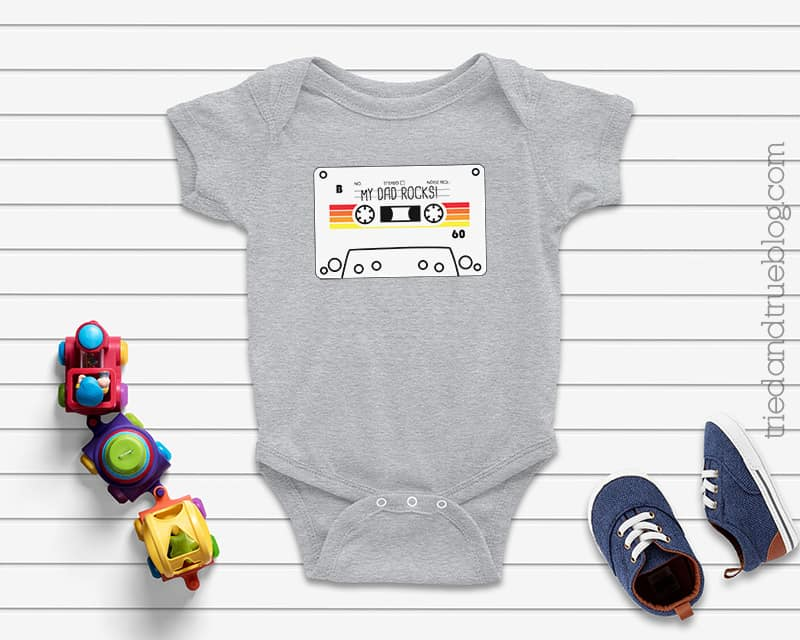 """Gray baby onesie with a Cassette Tape Father's Day Card Free Printable that says """"My Dad Rocks!"""""""