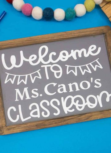 Custom Chalkboard Back To School Gift on blue background surrounded by school supplies.