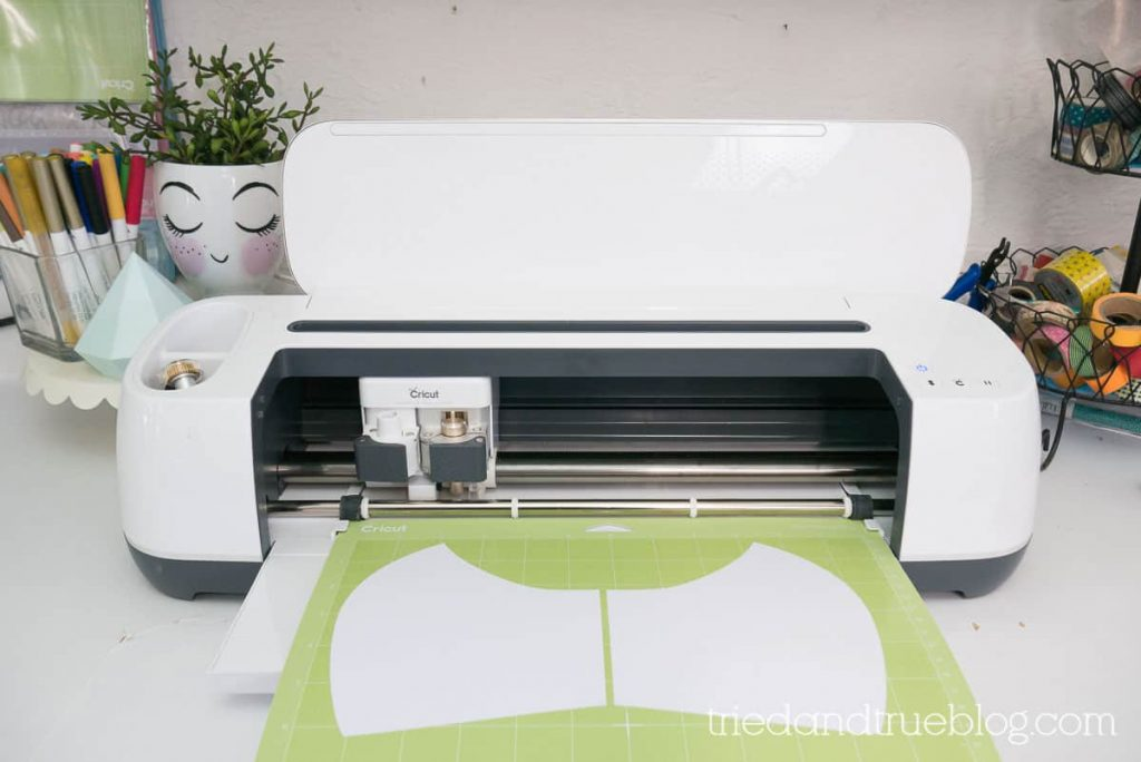 Image of Cricut Maker on a counter with craft supplies behind.