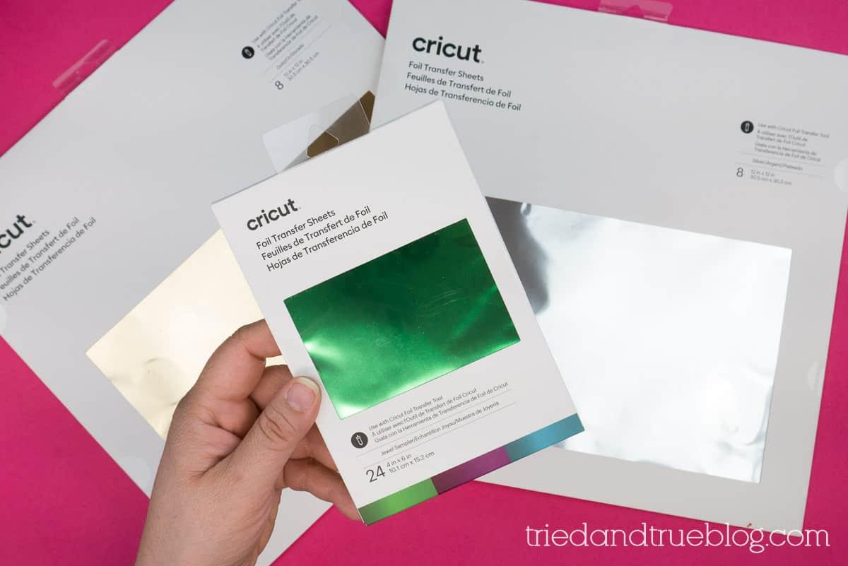 Hand holding Cricut Foil Transfer Sheet packaging.